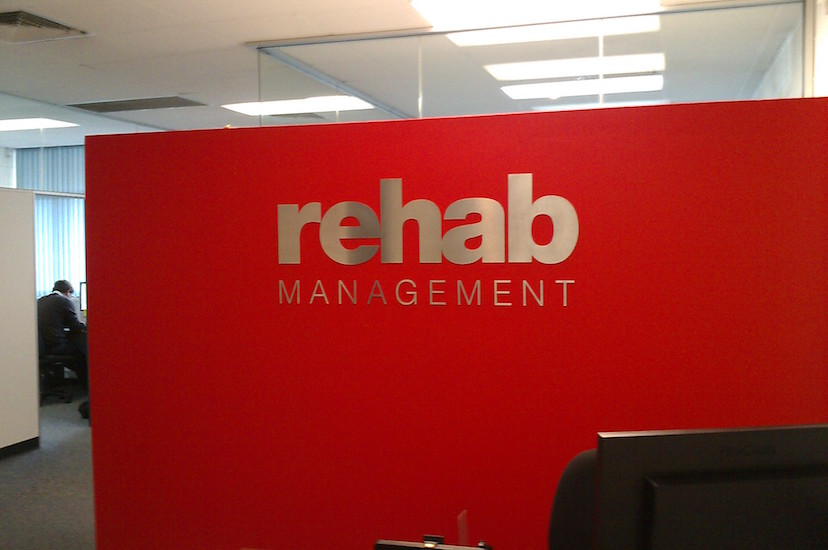 rehab management reception sign